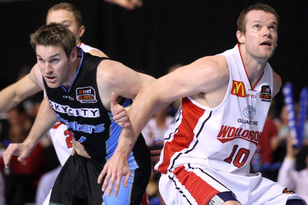 Dillon Boucher tussles for position during the Breakers win over the Wollongong Hawks.