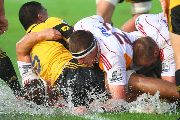 Hurricanes and Chiefs players scramble for the ball in the wet at Taupo.