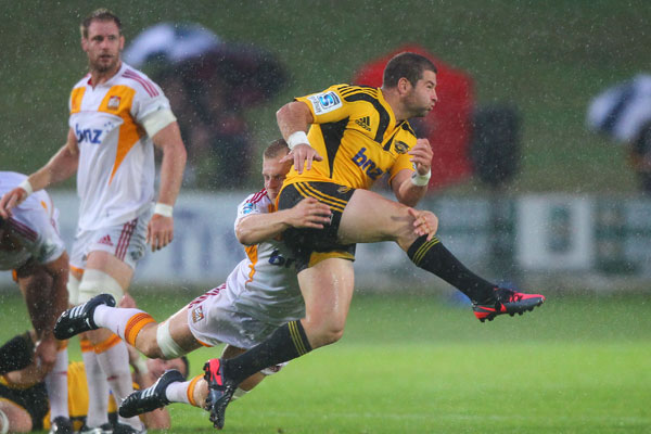 Chris Smylie gets a kick away against the Chiefs in Taupo.