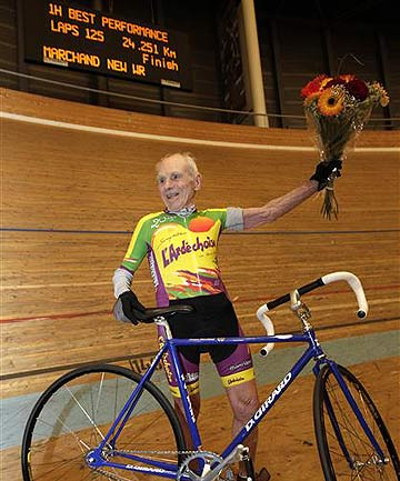 Robert Marchand of France celebrates after setting a world record for cycling non-stop for one hour, in the over 100-year-old category.