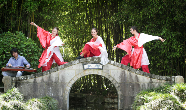 Free festivities: XiYao Chen plays the gu-zheng while Marie Hermo Jensen, Alex Hitchmough and Claire Gray embrace being in the Chinese Scholars Garden for their site-specific dance Whispering Birds, which is part of the Waikato Times Hamilton Gardens Arts Festival.