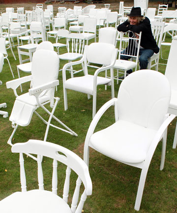 Peter Majendie sits among the 185 white chairs he prepared to commemorate the Christchurch earthquake victims.