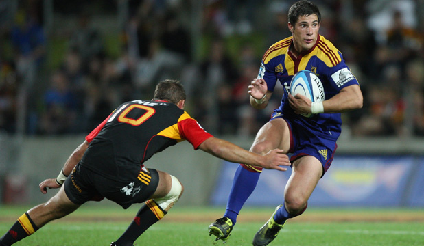 MAKING THEM PAY: Phil Burleigh of the Highlanders in action against the Chiefs.