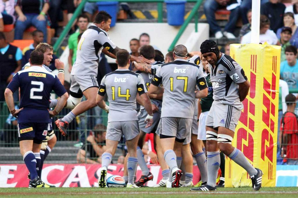 Hurricanes celebrate a try against the Stormers at Newlands.