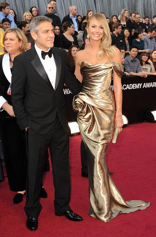 Looks like Stacy Kiebler, otherwise known as George Clooney's current squeeze, has been doing a bit of DIY dressmaking with this gold horror.