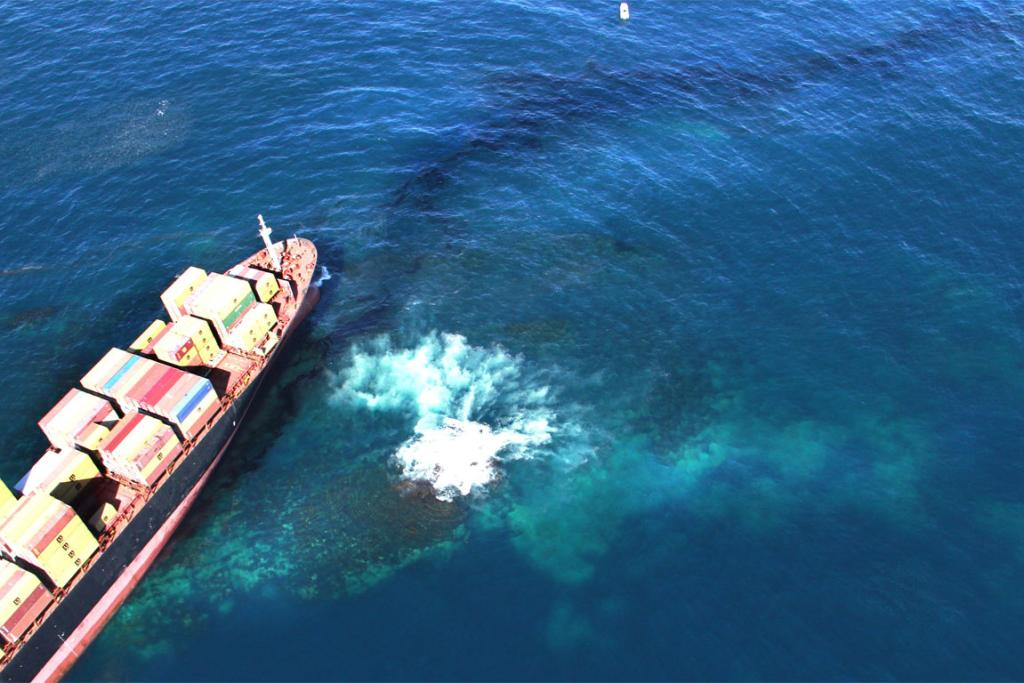 The crippled Rena, with  a growing oil slick, off the coast of Mt Maunganui.