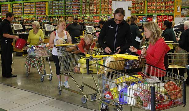 Shoppers queue in Pak 'n' Save in Kilbirnie.