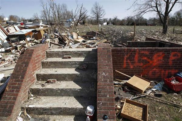 People survey the destruction caused by a tornado in Harrisburg, Illinois.