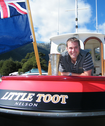 Clint Skelton, of Nelson, and his miniature tugboat Little Toot won the Jens Hansen Cup for best overall vessel at the annual New Zealand Antique and Classic Boat Show at Lake Rotoiti at the weekend.