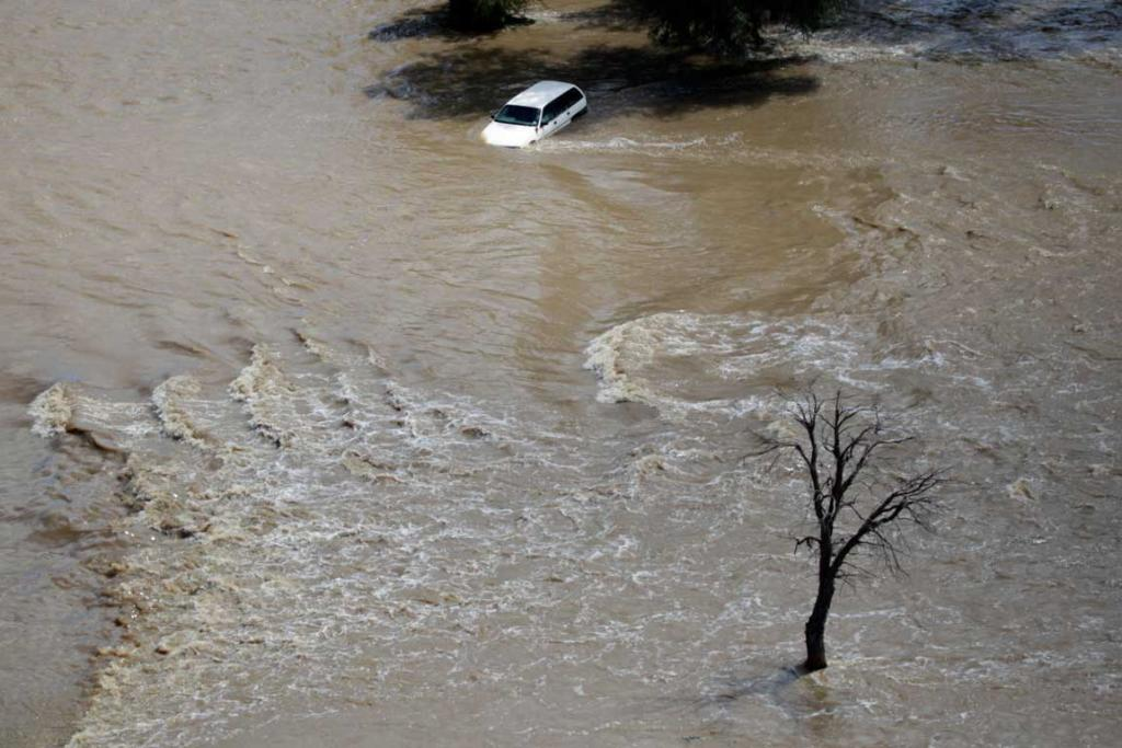 An abandoned vehicle is washed way by flood waters at North Wagga Wagga on March 5, 2012.