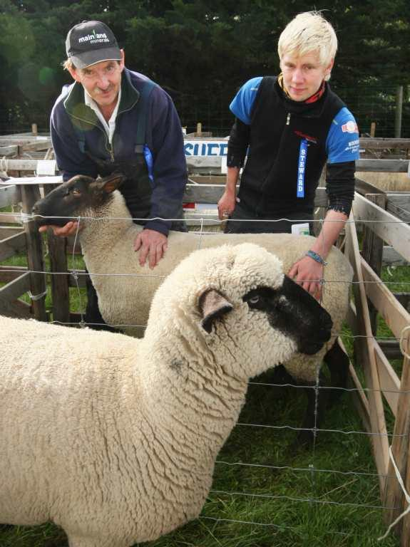 SOUTHLAND A & P SHOW: Doug McLeish and Magne Andersen check out south suffolk and hampshire breeds at the Southland A&P Show at Donovan Park, Invercargill.