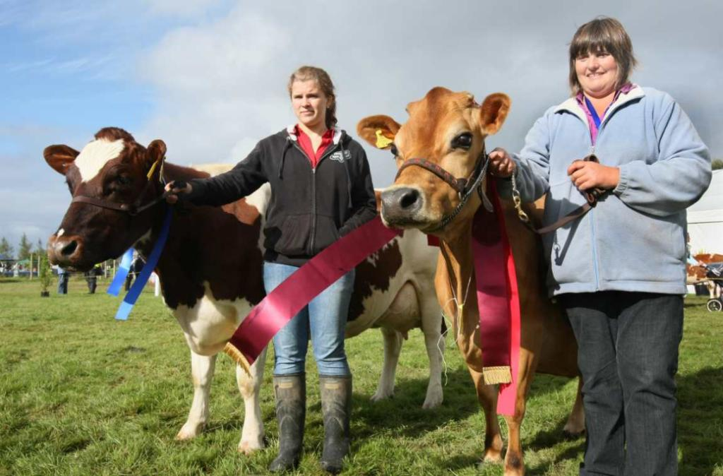 SOUTHLAND A & P SHOW: Gabby Hitchcock, left, of Invercargill, was second in the all breeds section, while Linsey Bennett, of Tuatapere, won first place with her cow Mount Lake Vanity.