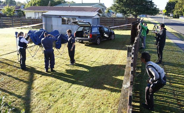 COLD CASE: Police at the Tokoroa property where they are searching for a body.