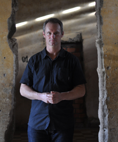 HARROWING: Olympian and rowing champion Rob Hamill in Phonm Penh's Genocide Musuem, the notorious former Khmer Rouge prison camp S-21 at Tuol Sleng.