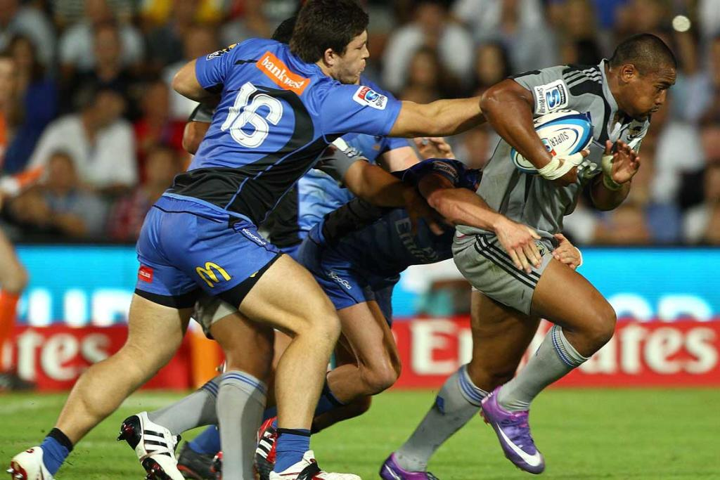 Julan Savea of the Hurricanes looks to push forward against the Western Force.