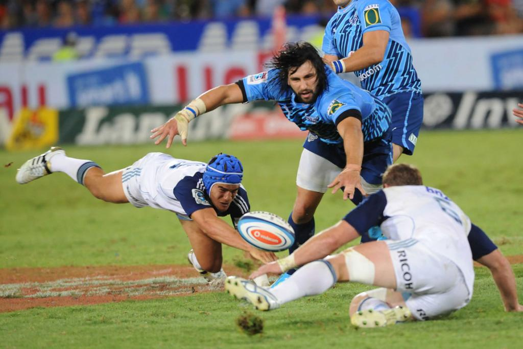 Jacques Potgieter of the Bulls is tackled by Benson Stanley and Luke Braid of the Blues.