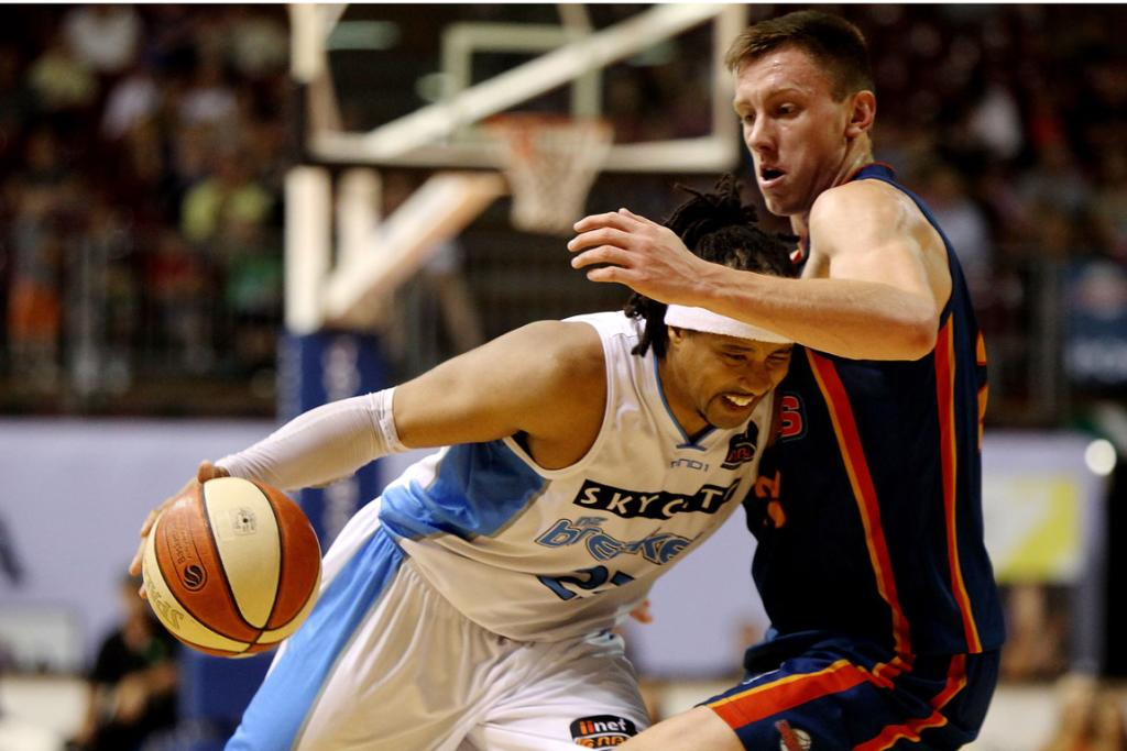 CJ Bruton of the Breakers surges forward  against the Adelaide 36ers.