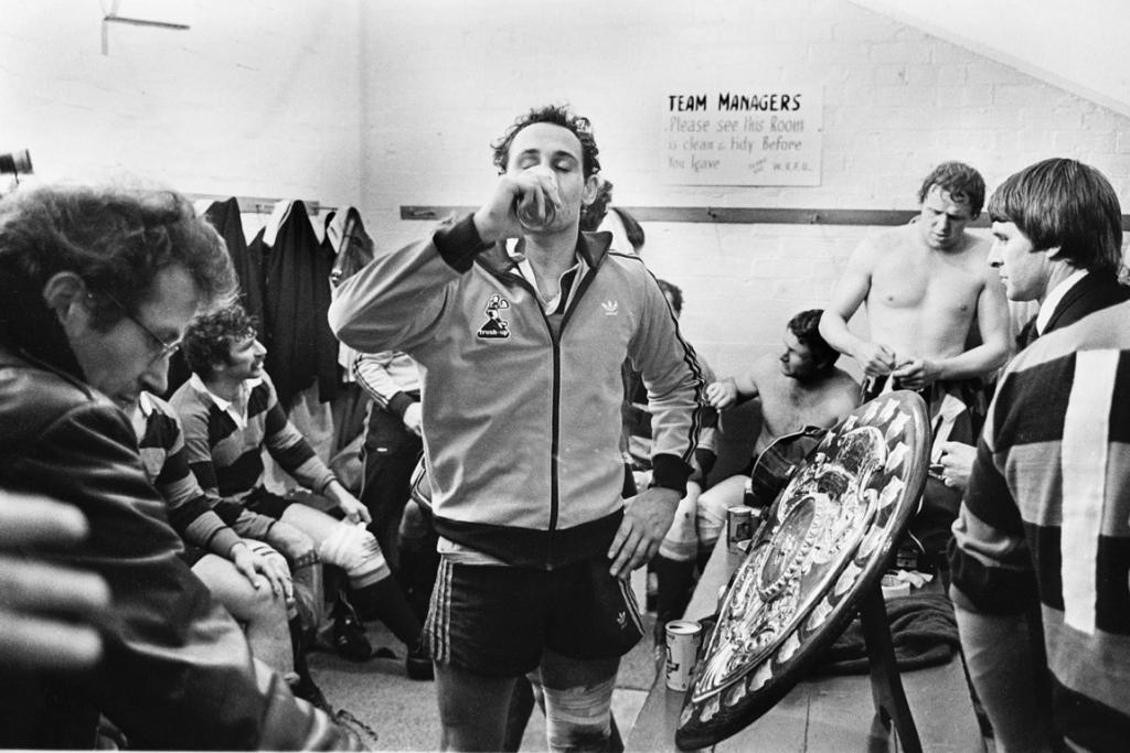 Jock Hobbs has a well earned can of Freshup in the dressing room after winning the Ranfurly Shield for Canterbury off Wellington at Athletic Park on September 18, 1982.