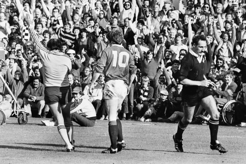Jock Hobbs runs back to position afer scoring a try for the All Blacks during the 4th test against the British Lions at Eden Park on July 16, 1983.