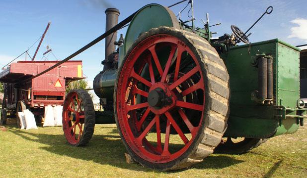 ROLLING: The club's 1908 Fowler traction engine (known as the Mowat engine after the late Eric Mowat) driving a wooden threshing mill.