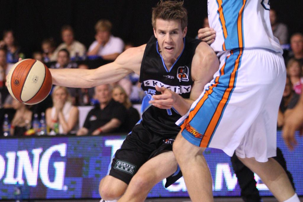 Breakers forward Thomas Abercrombie drives on Gold Coast Blaze centre Will Hudson.