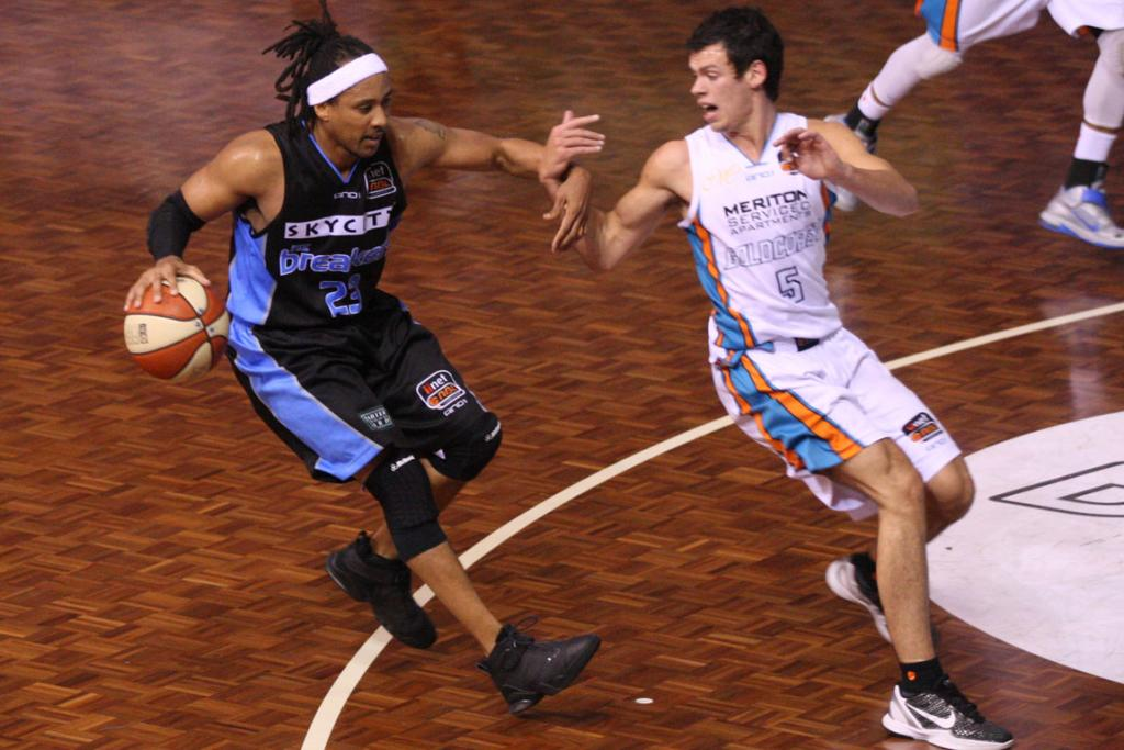 Breakers guard CJ Bruton pushes off Gold Coast Blaze point guard Jason Cadee.