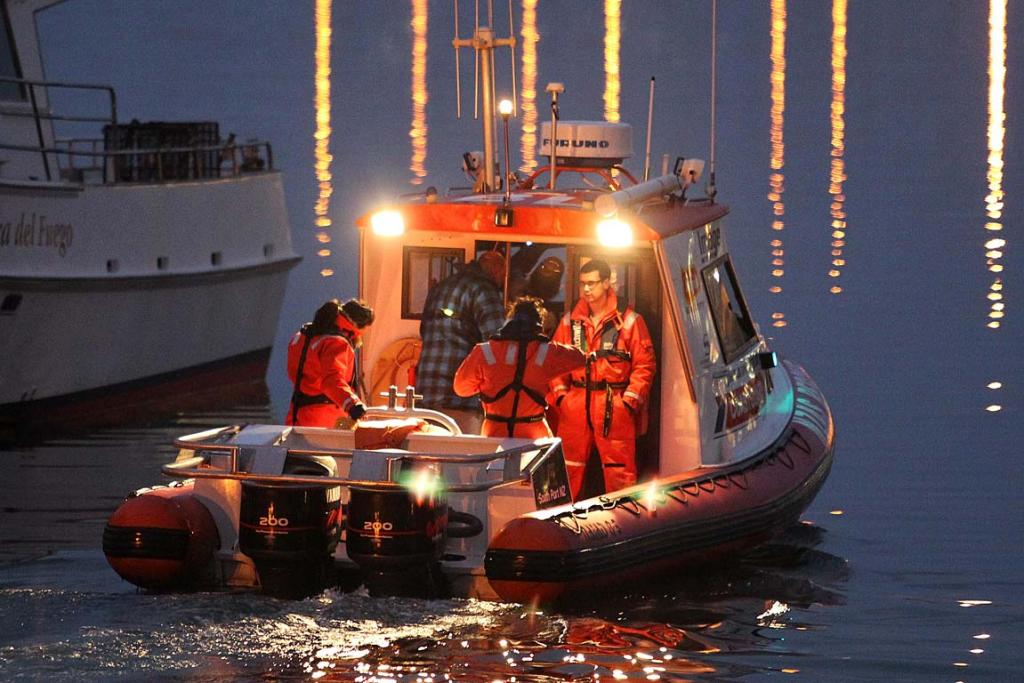 The coastguard goes out before dawn on the search for people missing off the boat Easy Rider.