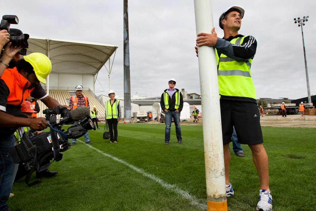 Dan Carter helps as the goalposts go in at Christchurch Stadium..