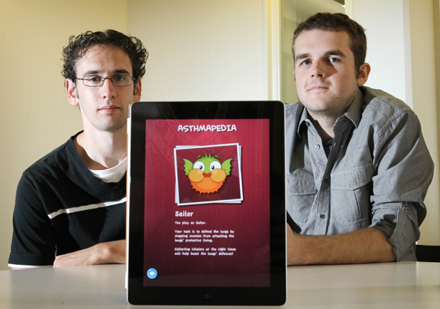 INTERACTIVE LEARNING: Ben Squires, left, and Daniel Loomb are helping children to beat asthma with the iPad app they developed in conjunction with Asthma Waikato.