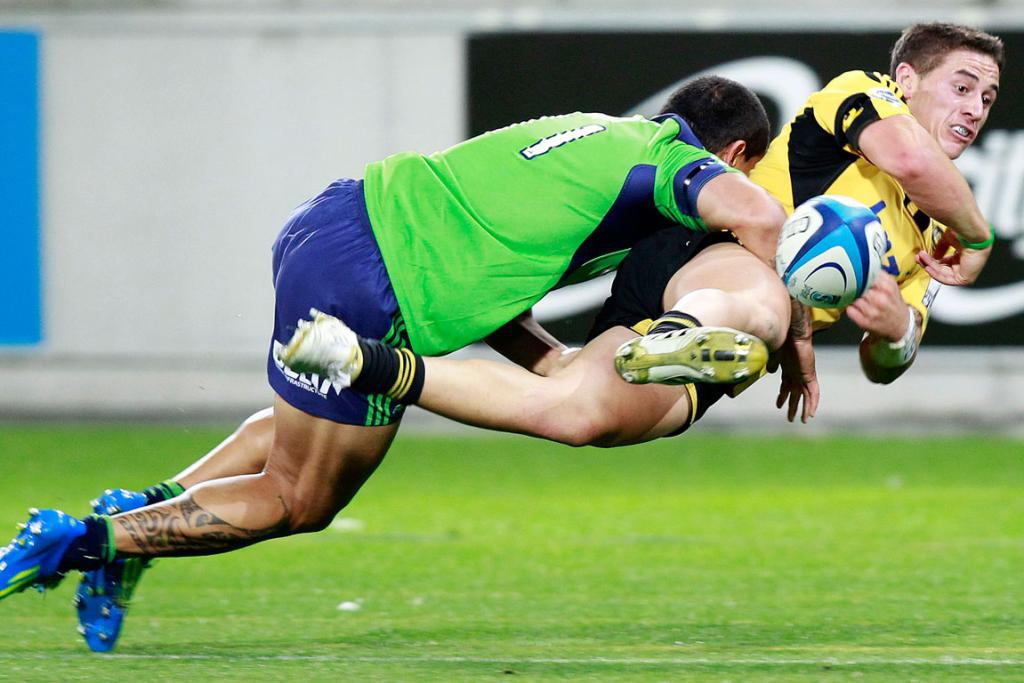 TJ Perenara of the Hurricanes and Hosea Gear of the Highlanders tangle.