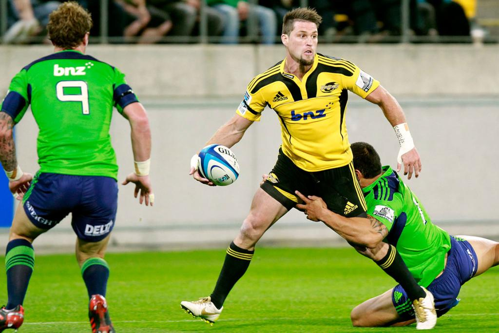 Cory Jane of the Hurricanes on his way to scoring a try during the first half against the Highlanders.