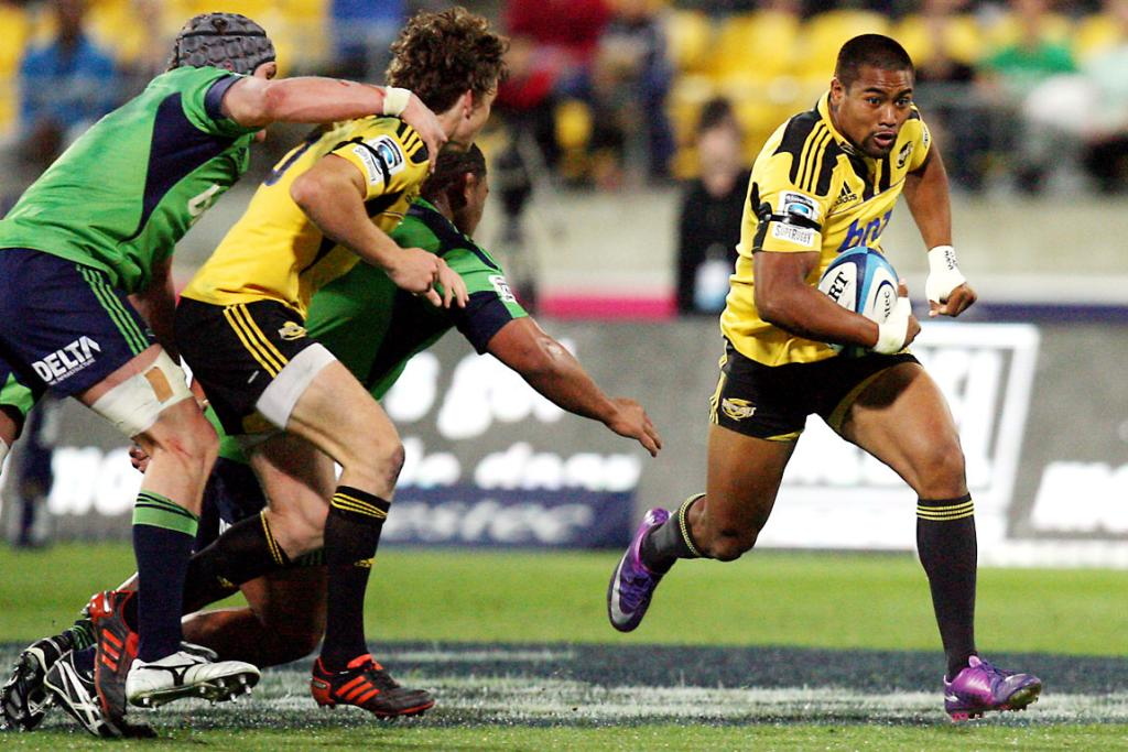 Julian Savea of the Hurricanes on the charge against the Highlanders.