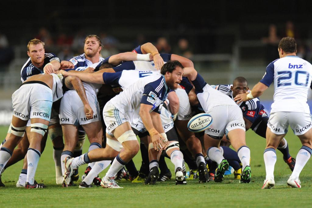 Chris Lowrey of the Blues passes against the Stormers.