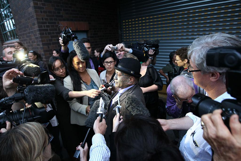 Tame Iti surrounded by media