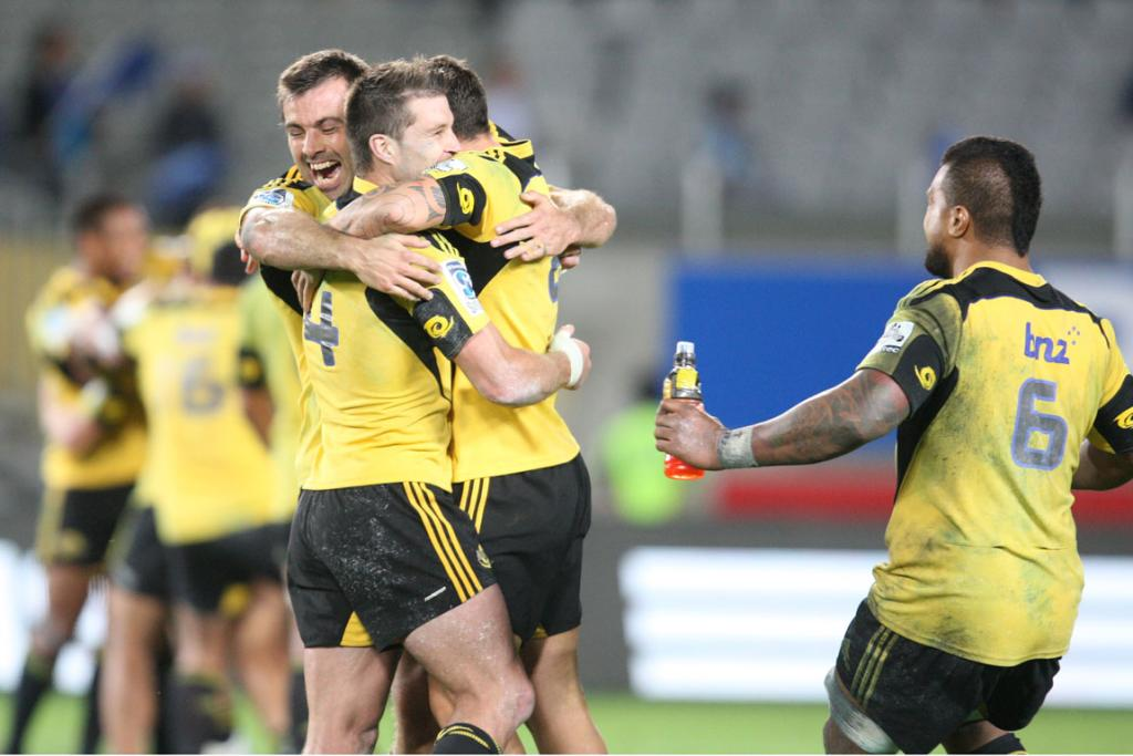 Hurricanes centre Conrad Smith, wing Cory Jane and halfback TJ Perenara celebrate at the final whistle.