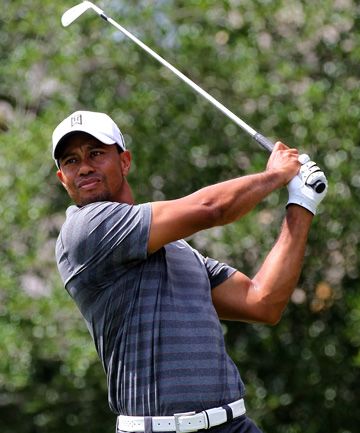 LEADER: Tiger Woods plays a shot on the 5th hole during the third round.