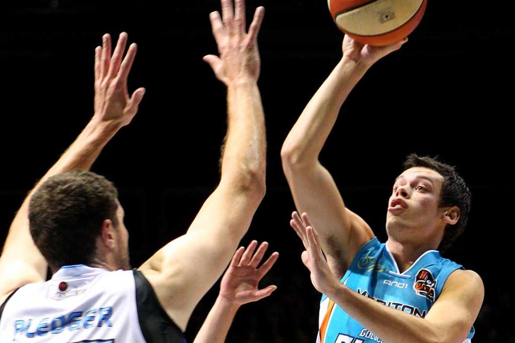 Jason Cadee of the Blaze shoots during their match against the Breakers at the Gold Coast Convention Centre.