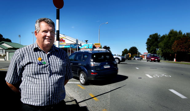 CAREFUL DRIVING: South Canterbury road safety co-ordinator Daniel Naude keeps an eye on traffic at the Otipua Rd-Church St intersection as drivers face their first weekday with the new give way rules.