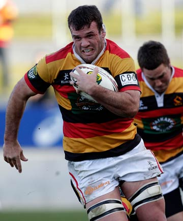 RUNNING MAN: Alex Bradley makes a break for Waikato in a game against Auckland.
