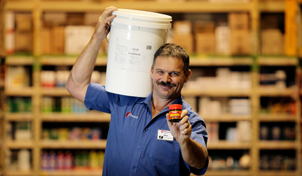 Gilmours Hamilton branch owner Rick Donaldson with the bucket of Marmite.