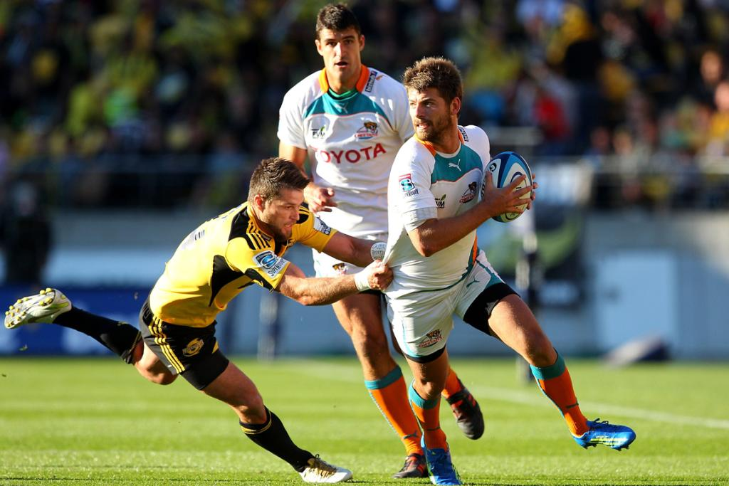 Willie le Roux (right) of the Cheetahs is tackled by Cory Jane of the Hurricanes.