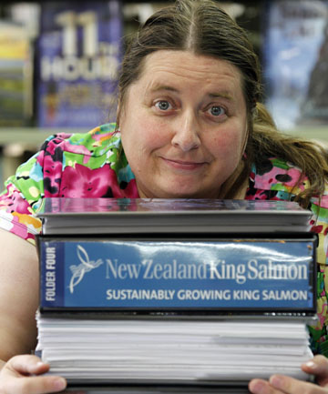 Page-turner:  Sandra Parker, reference librarian at Blenheim Library, holds the four ring-binders of information about the New Zealand King Salmon proposal to develop nine new marine farms in the Marlborough Sounds
