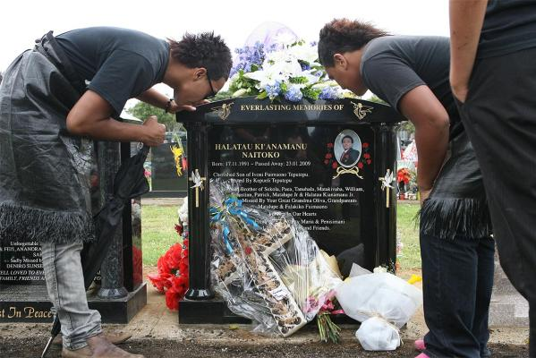 Paea Fangufangu (left) and Tanu Niatoko (right) at the headstone unveiling of Halatau Naitoko at South Auckland's Mangere Cemetery.
