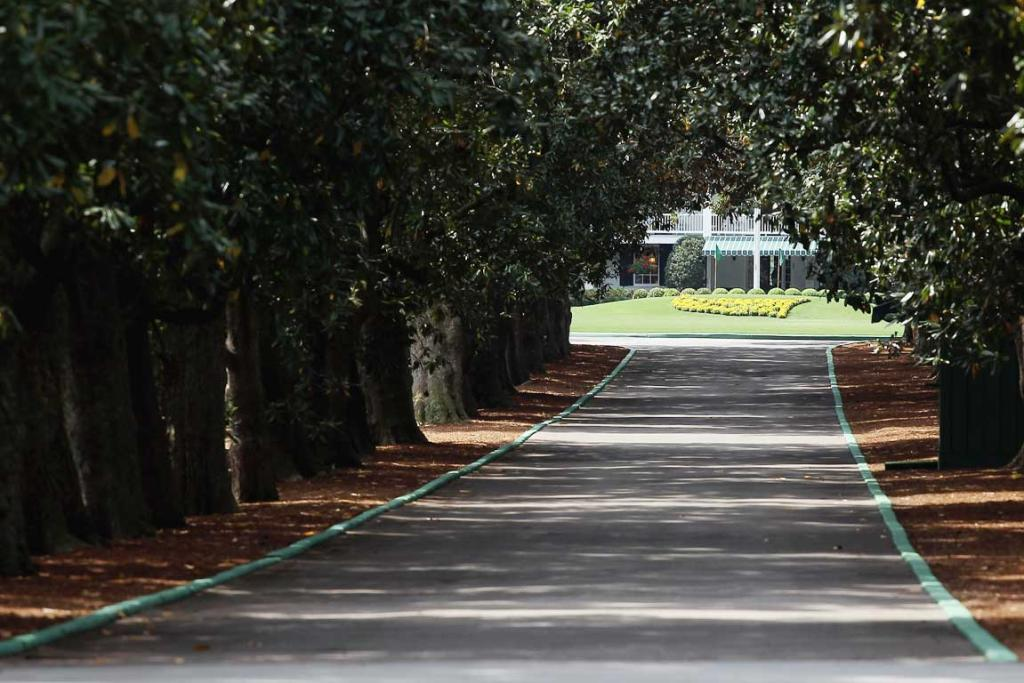 Magnolia Lane's 60 magnolia trees and the clubhouse are seen at Augusta National Golf Club before The Masters .