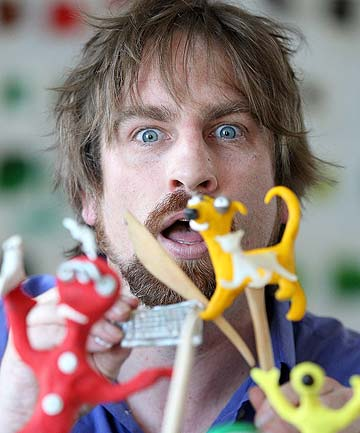CLAY-TASTIC: Animator and comedian Guy Capper holds some of the plasticine moulds he uses for stop motion animation.
