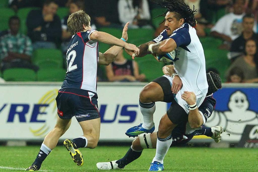 Ma'a Nonu of the Blues looks to get past James O'Connor of the Rebels.