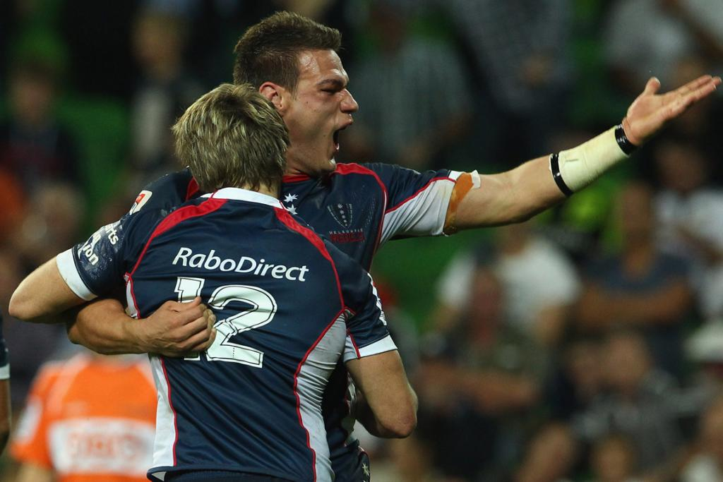 James O'Connor of the Rebels celebrates with Mitch Inman after he scored against the Blues.