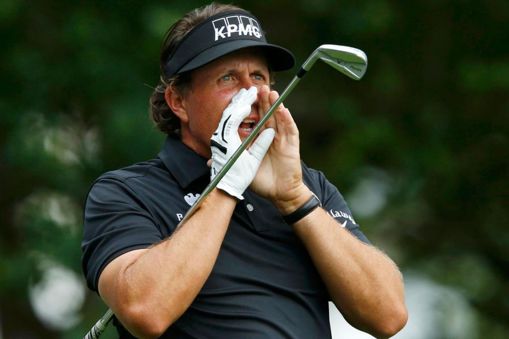 American Phil Mickelson warns the gallery after an errant tee shot on the fourth hole.
