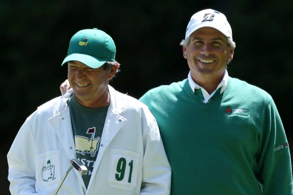 Fred Couples walks off the 13th green with his caddie David Kerr.