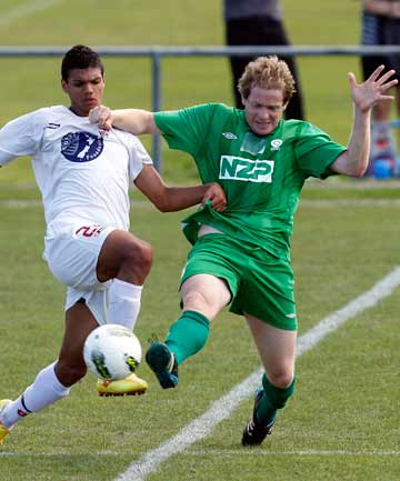 DIVING IN: YoungHeart Manawatu midfielder Matt Kennedy battling with Ryan De Vries in Waitakere United's 6-1 win in Auckland.